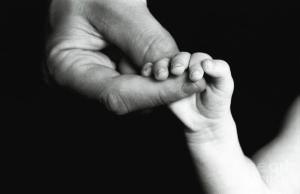 holding baby's hand